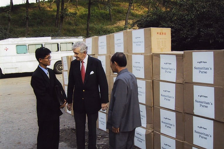Samaritan's Purse Board Member Dr. Melvin Cheatham presents medical supplies to a delegation in North Korea.