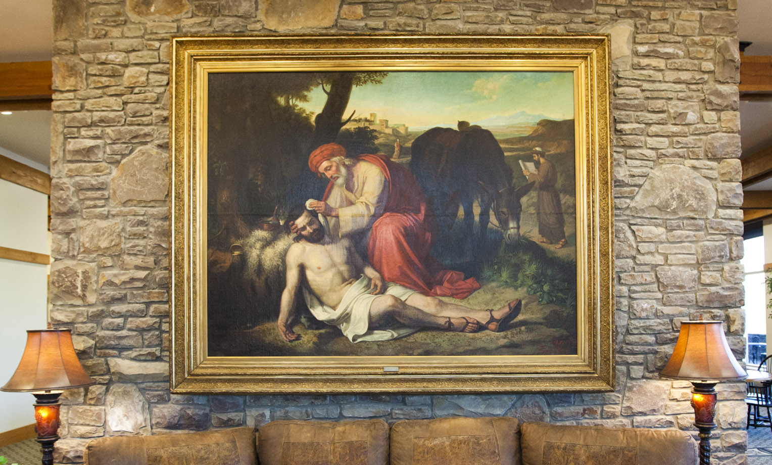 """""""La Caridad del Samaritano"""" literally translated, """"The Charity of the Samaritan"""" is an oil painting by Spaniard Jose Tapiro y Baro (1863-1913) depicting the story of the Good Samaritan from Luke 10:30-37. A gift to Samaritan's Purse in 2011 from the Gamboa Family Trust, the work of art is a reminder to all of Christ's followers to """"Go and do likewise."""" This painting hangs at the entrance to the Furman Building at the ministry's international headquarters in Boone, North Carolina."""