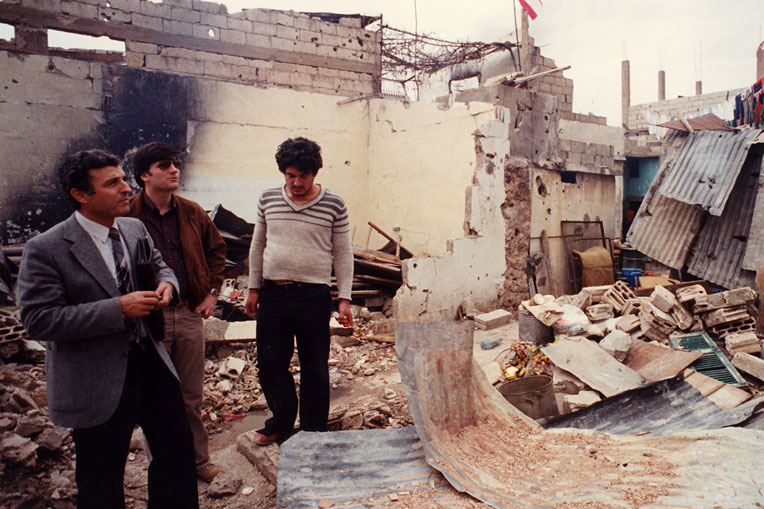 Sami Dagher and Franklin Graham survey damage from the war.