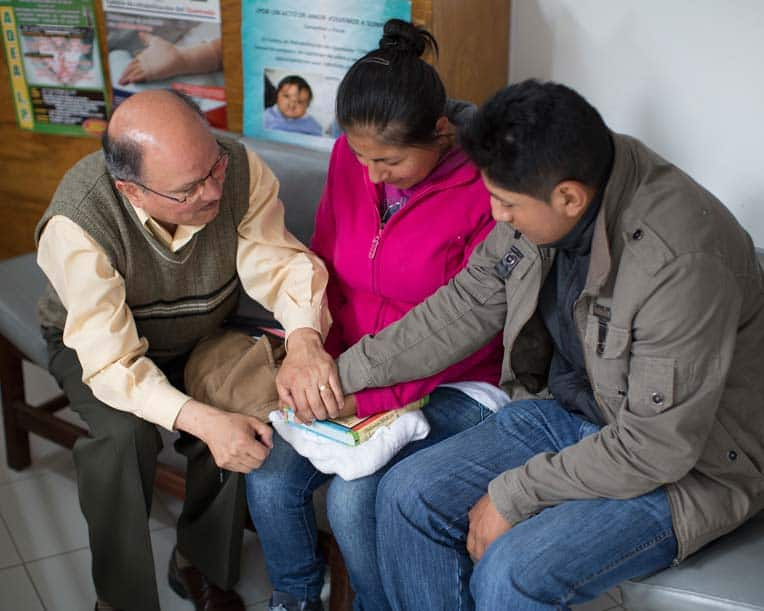 Pastor David Archondo of La Paz prayed with Carla and Juan Carlos before their son had surgery in 2015.