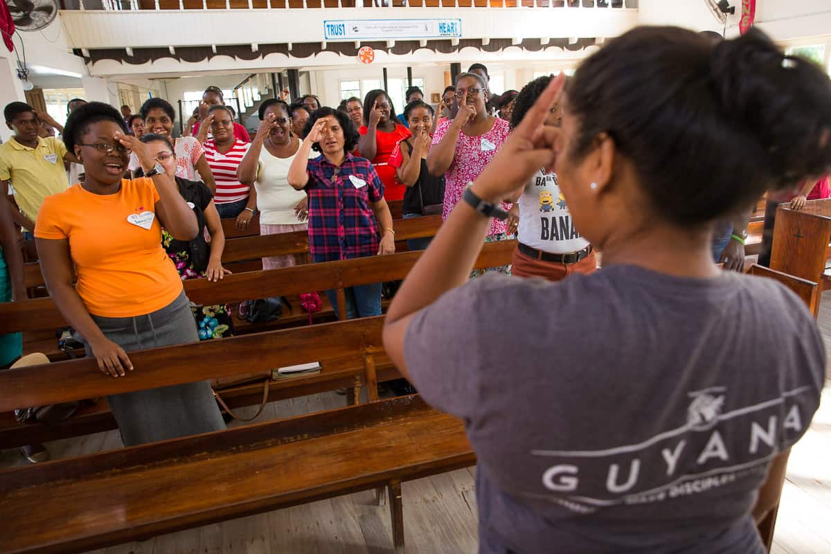 Geeta demonstrates a song with hand motions that can engage children with the Gospel.