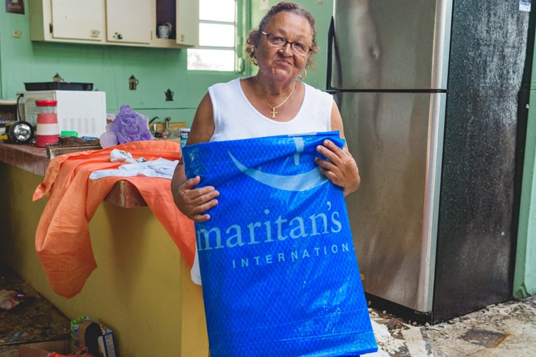 Doris Morell was grateful to receive heavy-duty shelter tarp from Samaritan's Purse.