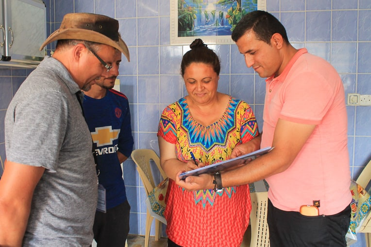 A Christian homeowner in Qaraqosh signs off on completed repairs from Samaritan's Purse