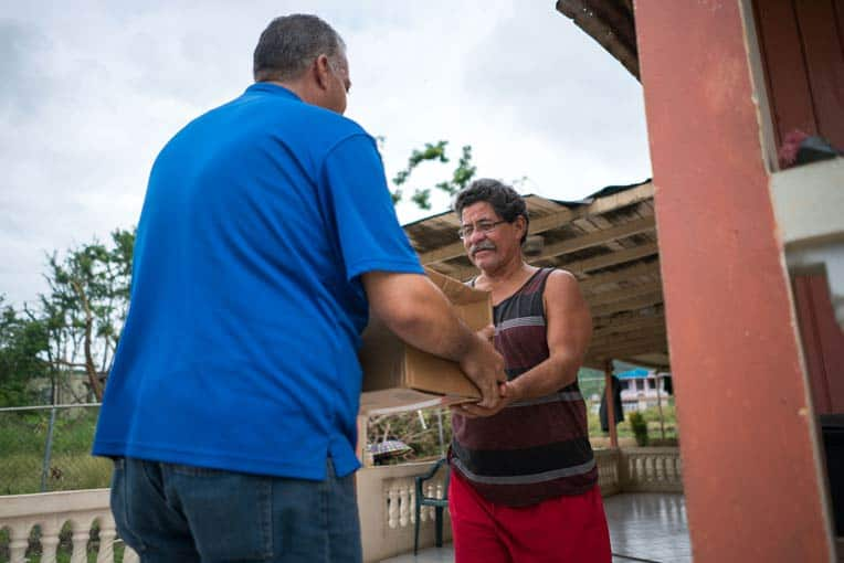 Local churches are distributing food to households in their area.