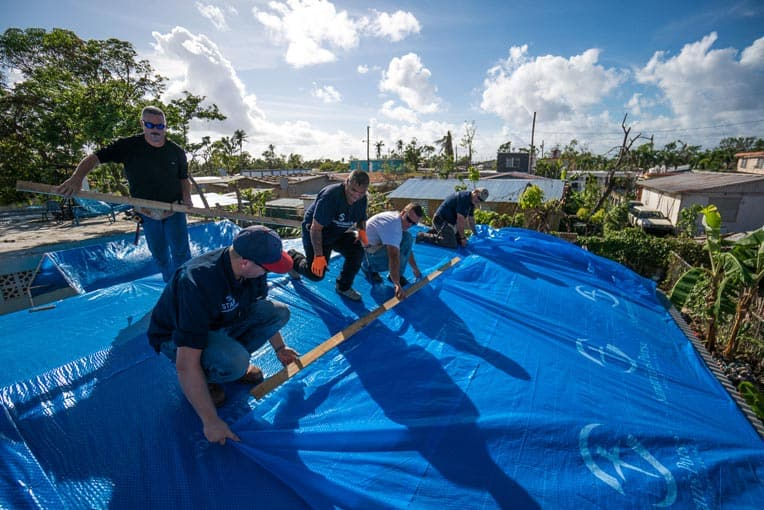 Puerto Rico is covered in blue—more than 70,000 tarps have been distributed. This team installed the tarp on the home of a widow whose husband was killed in Hurricane Irma (before Maria).