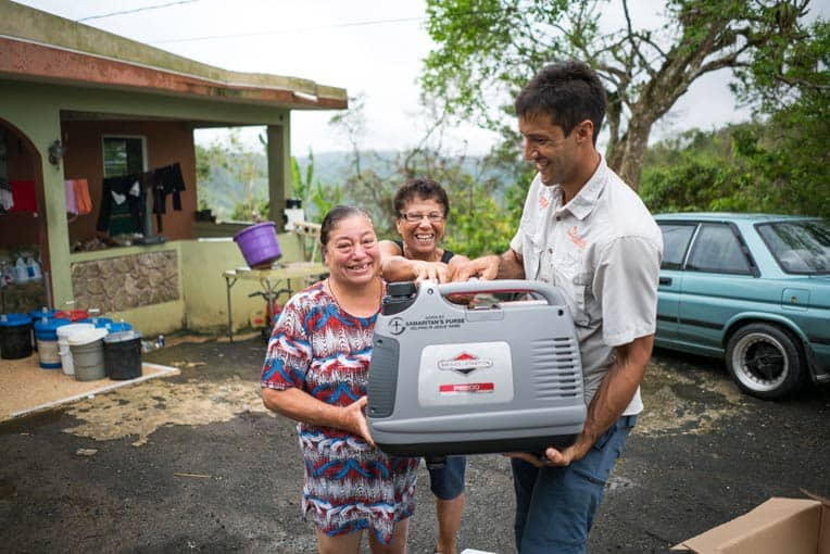 Blanca Judith Colon (at left) received a generator from Samaritan's Purse to help her care for her disabled son. Her aunt, Elsa, is at center, and Andres Morales is at right.