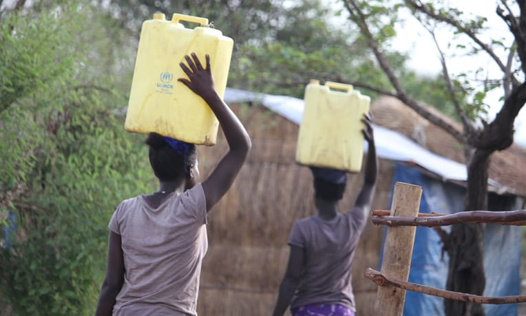 Water is a constant need in the refugee settlement camps. Women are often in charge of gathering water.