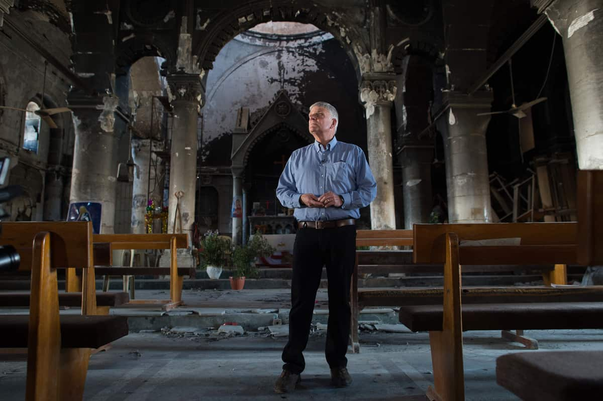 Franklin Graham stands inside a church destroyed by ISIS in Qaraqosh, a traditional Christian village outside of Mosul, Iraq.