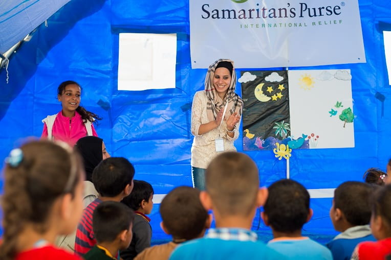 """""""We are teaching them to dream, look to the future, respect each other, and live in peace,"""" said Sura, a Baghdad native who teaches a class in our Child-Friendly Space."""