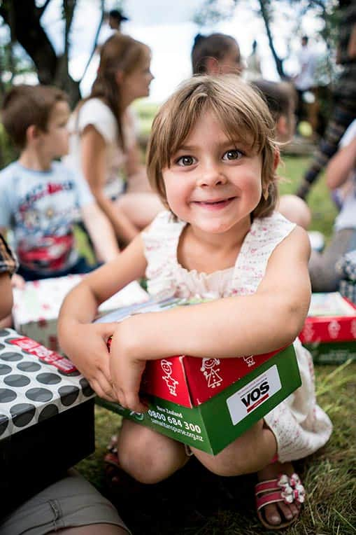 Myroslava, 5, is excited to receive her shoebox gift!