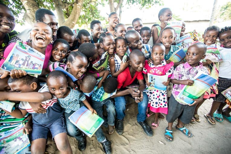 Kwale celebrates with students in The Greatest Journey class he teaches.