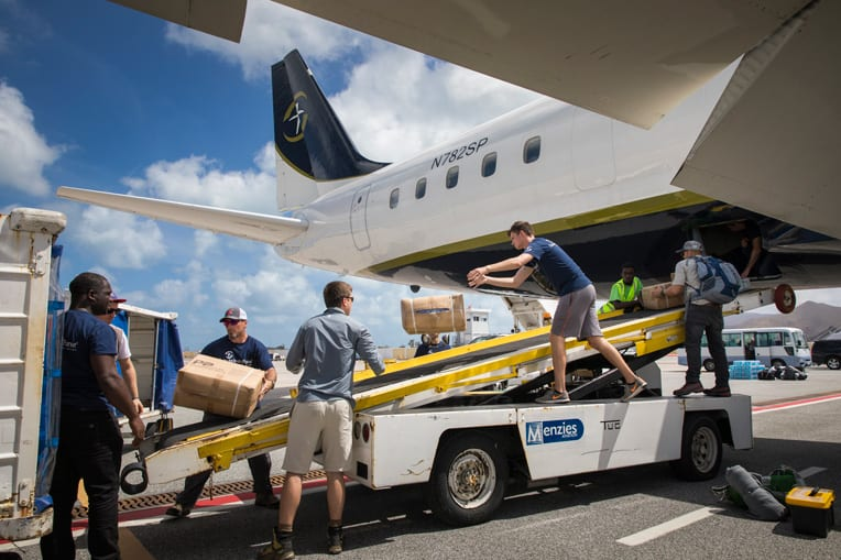 Staff unloading the DC-8 in St. Martin.