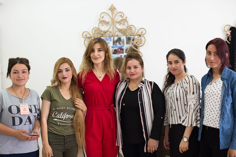 Sarina (second from left) and Marwa (third from left) with ladies in the Northern Iraq Community Center salon.