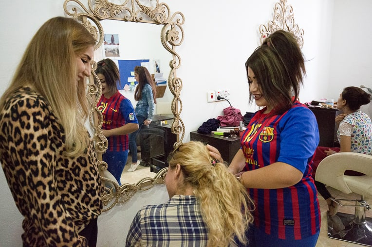 Angel (right) learns how to become a beautician from her instructor Marwa (left).