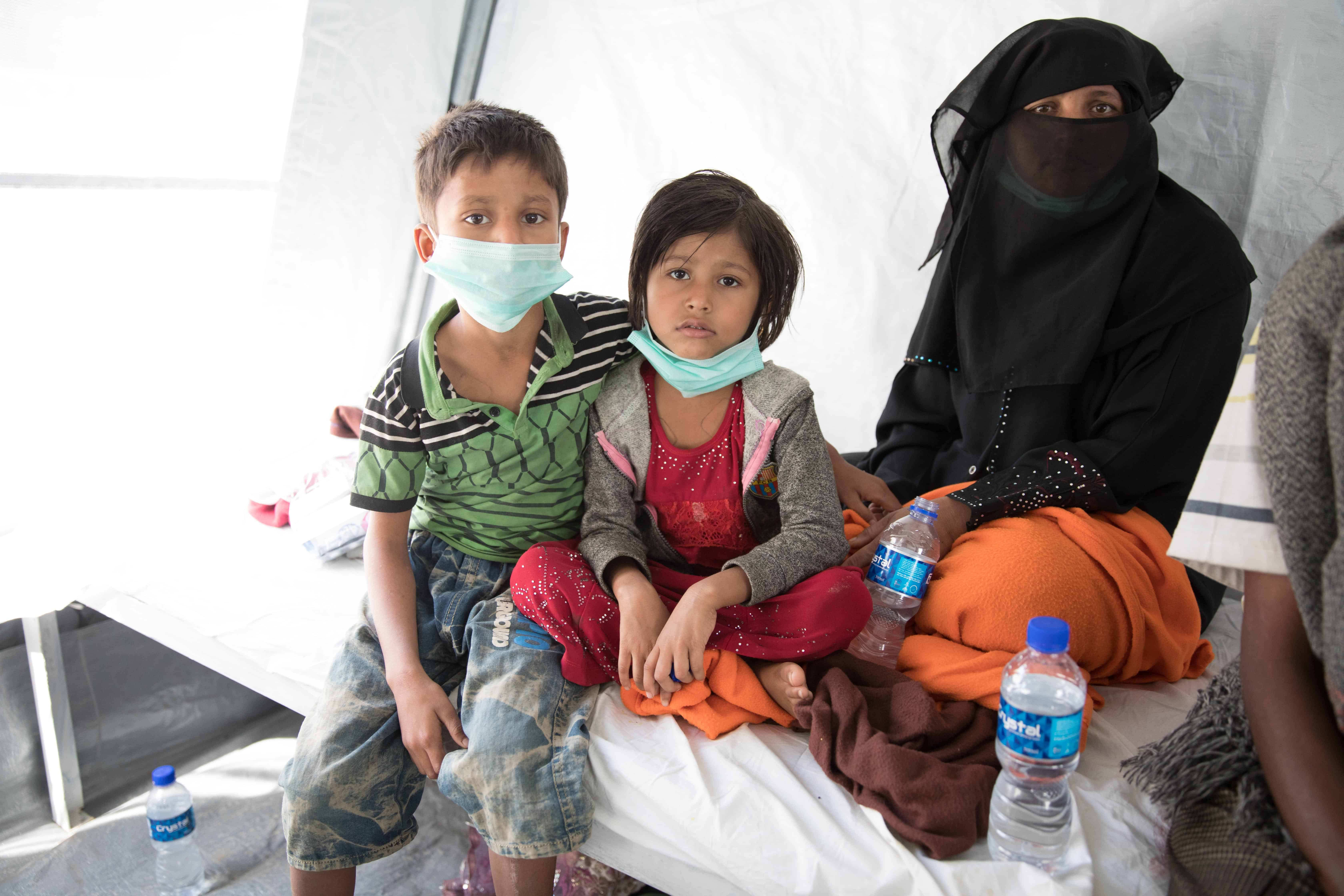 Shamshu (right) with Ziau (left) and Rogina (middle) at the Diphtheria Treatment Center.
