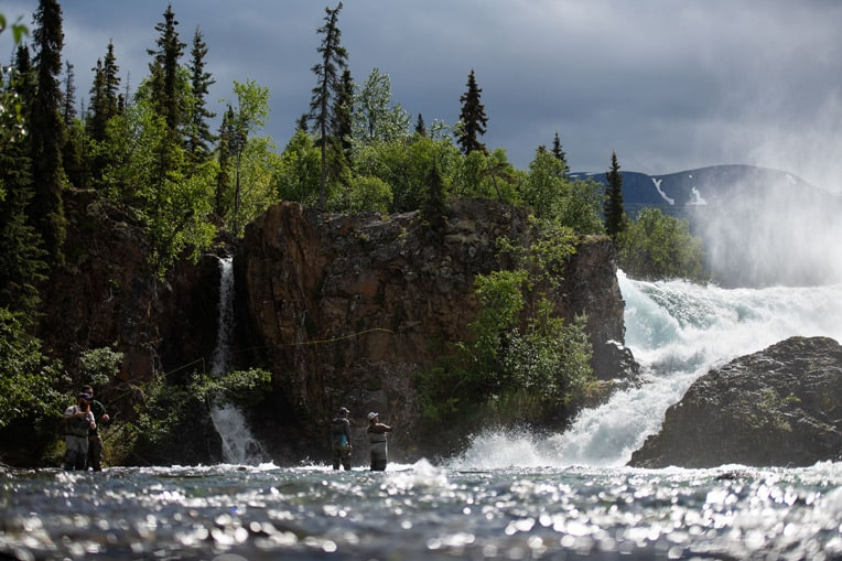 Military couples enjoy an afternoon fly fishing on the Tanalian River at the base of picturesque Tanalian Falls.