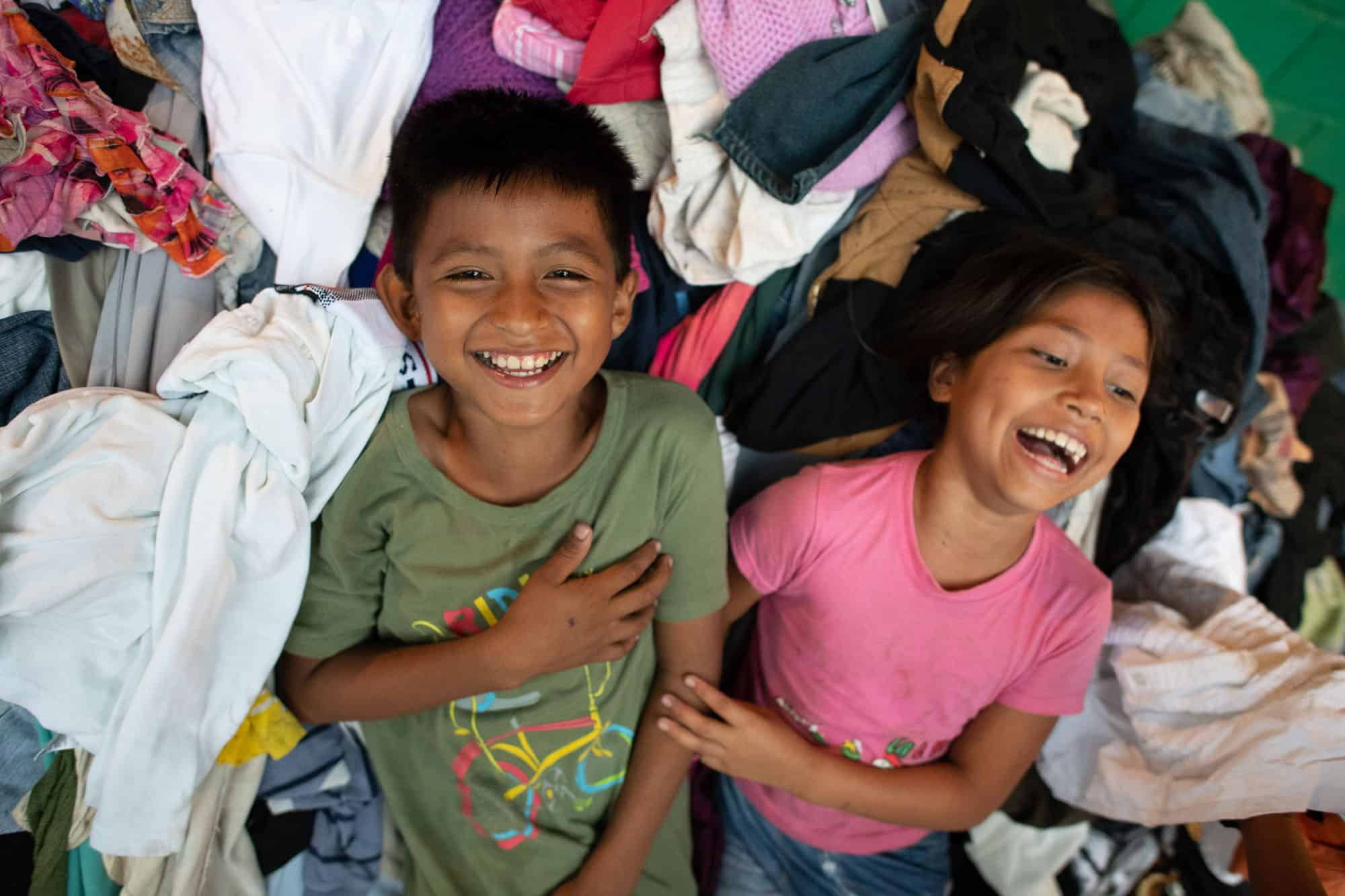 Even in a shelter stuff with belongings and supplies, there's still room for laughter after the volcano.