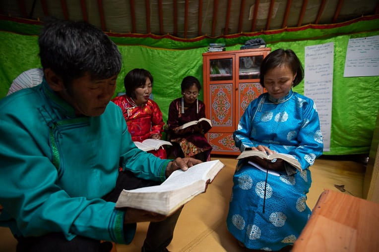 A church in Batnorov, Mongolia, that was planted in part through shoebox gifts meets in their yurt for a prayer meeting.
