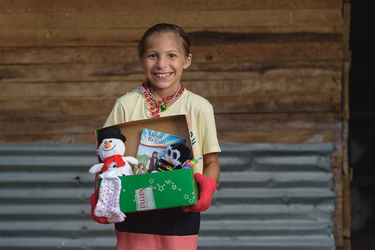 Kelly, one of 14 children from a local Colombian family, had never received gifts like these before.