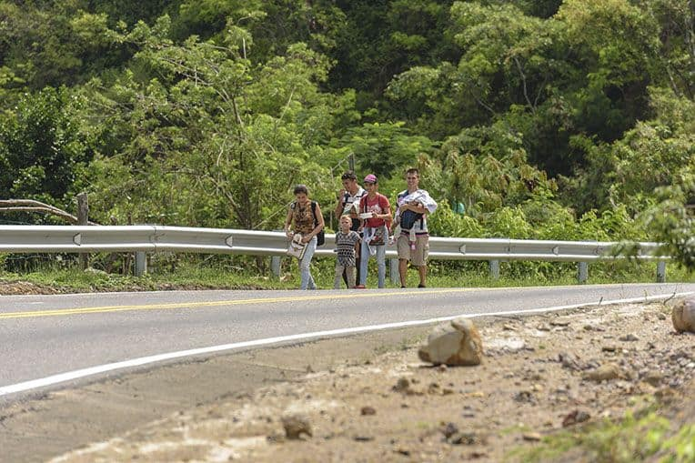 "Venezuelan ""walkers"" are a common sight along the roads near Cucuta."