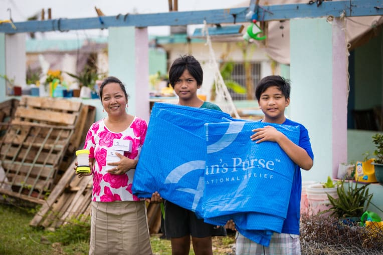 Chielo and her two sons are one of more than 1,800 families to receive emergency relief supplies from Samaritan's Purse in the devastating aftermath of Super Typhoon Yutu.