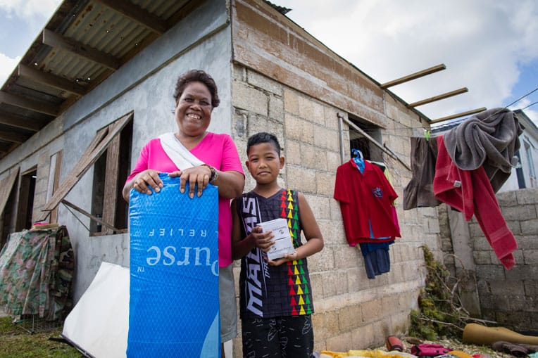The roof on Rosa and Tony's home was blown off during the typhoon, flooding their home with heavy rain.