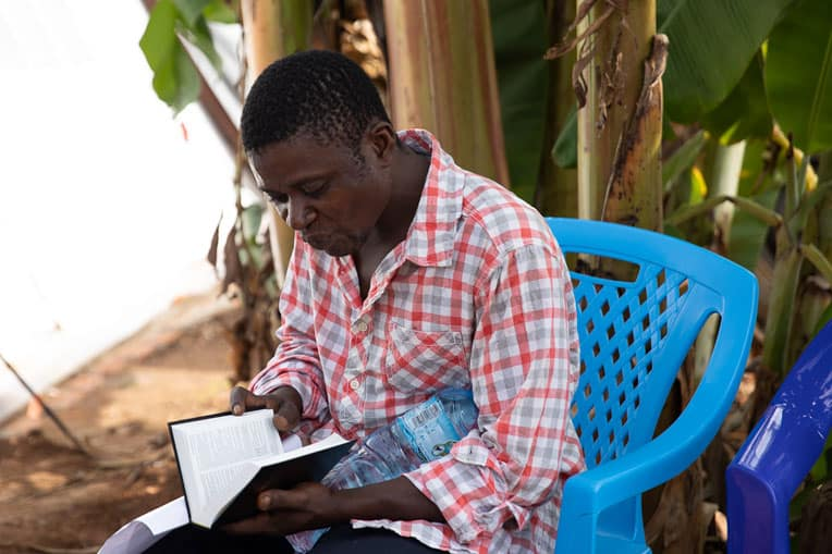 We gave Kavoro, a new Christian, a Bible in Swahili before he left the treatment center.