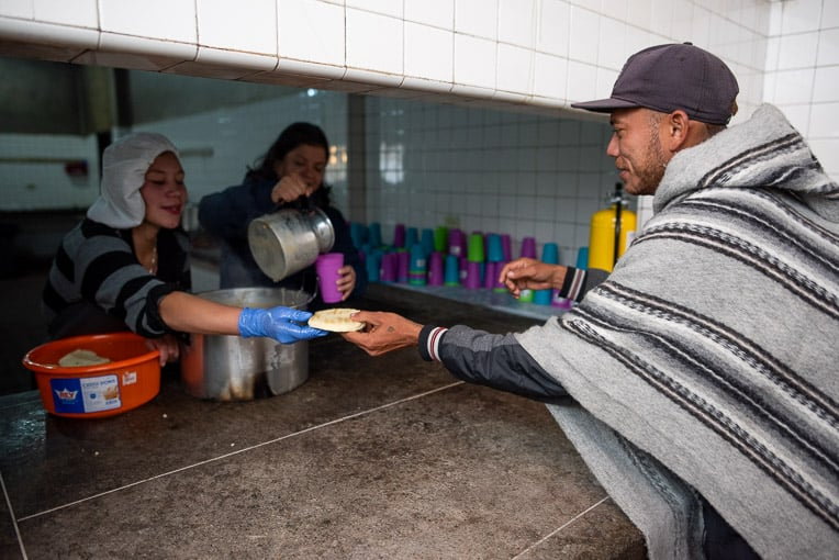 Migrants receive a hot meal at one of our shelters in Colombia.