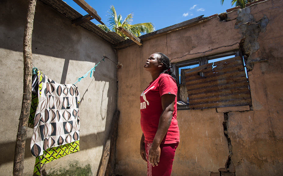 Lydia looks up to where her roof used to be, but is thankful to God for helping her start again.