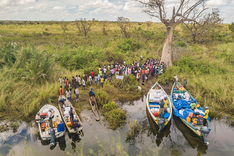 The roads into many communities were washed away. Our teams used boats to deliver tarps, water filtration kits, blankets, and solar lights.