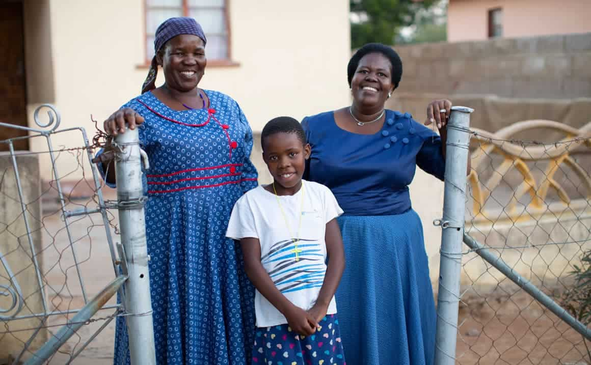 Queen's Sunday School teacher, (right), and her mother are excited to see Queen growing in her relationship with the Lord.