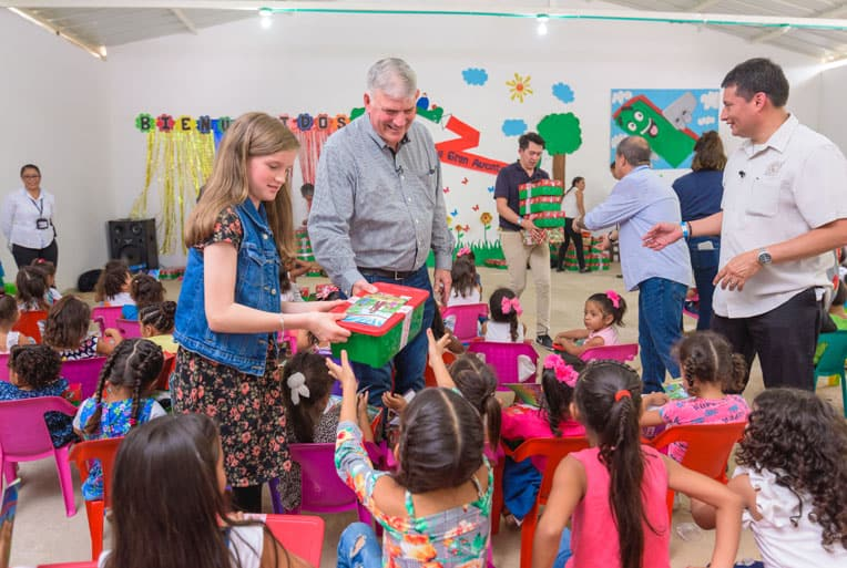 Franklin Graham and granddaughter Hannah help distribute gift-filled shoeboxes.