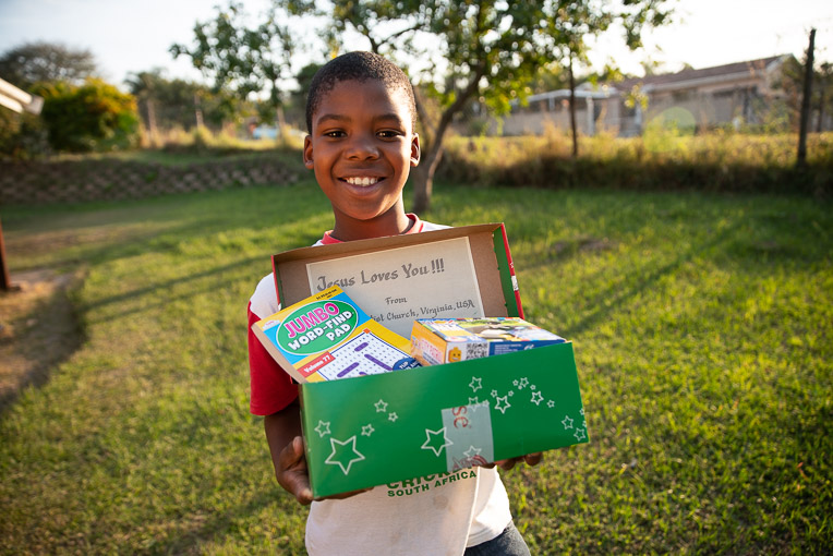 """This is my best day. I'm so happy,"" Titus said when he received his shoebox gift."