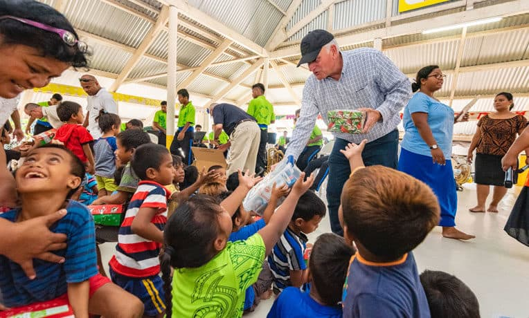 Samaritan's Purse President Franklin Graham hands out Operation Christmas Child shoebox gifts in the Pacific Island nation of Kiribati.