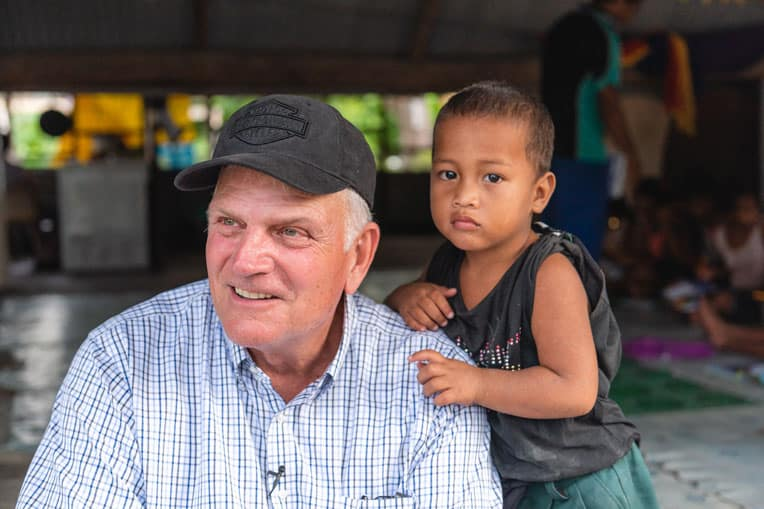 Samaritan's Purse President Franklin Graham meets one of many grateful children on Tarawa during his visit to Kiribati. As part of a new initiative, Operation Christmas Child is focused on reaching the children of 1,000 Pacific islands.