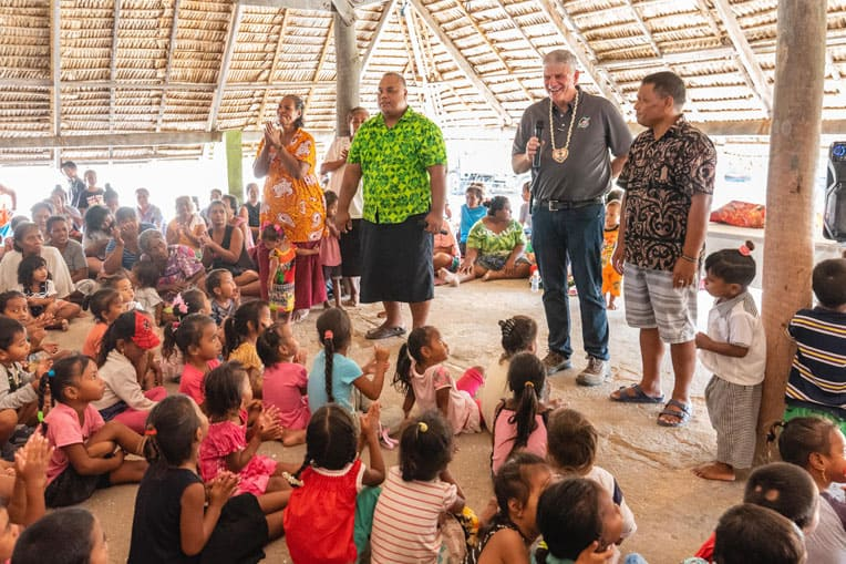 Franklin joins church leaders talking with children during one of many outreach events on Tarawa.