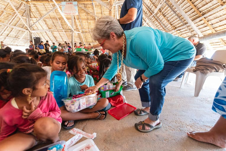 Jane Graham delivers gifts as well during an outreach event on the Pacific island of Tarawa.