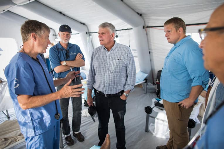 Franklin Graham speaks with our medical team in Freeport, Grand Bahama. We've already seen hundreds of patients at our field hospital.