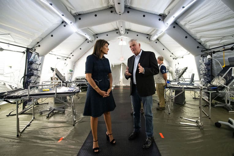 Samaritan's Purse President Franklin Graham provides former U.S. Ambassador Nikki Haley a glimpse of our Emergency Field Hospital on display at the conference.