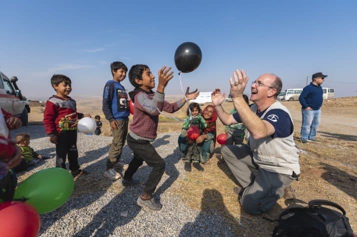 Samaritan's Purse staff seek to bring joy to children as they wait at Sehela transit center.