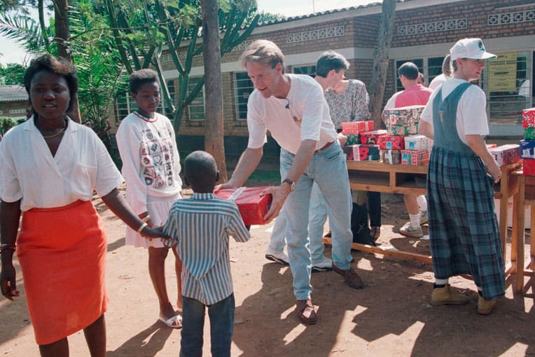 1994 - Pastor Skip Heitzig from Calvary in Albuquerque, New Mexico, and his wife Lenya led the team that brought shoebox gifts to children orphaned by the Rwandan genocide.