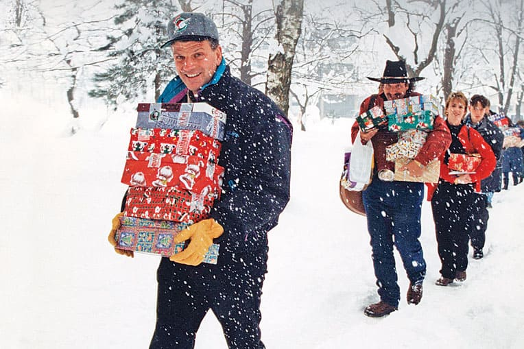 1995 - Franklin Graham, Dennis Agajanian, and others delivered shoebox gifts in Bosnia.