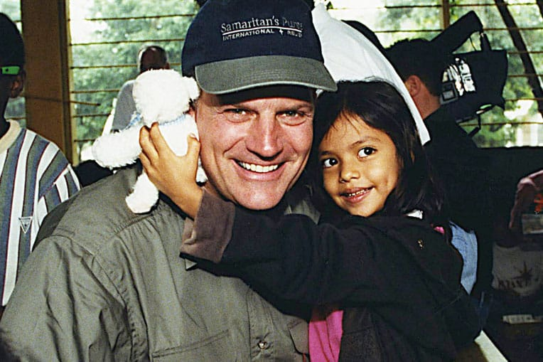 "1999 - At a shoebox distribution in a Honduran orphanage, Franklin Graham sang ""Jesus Loves Me"" to Juni, who received a toy lamb that played that tune."