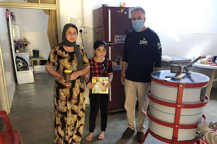Kameela* and her daughter Nadia* meet with a Samaritan's Purse staff person regarding beekeeping.