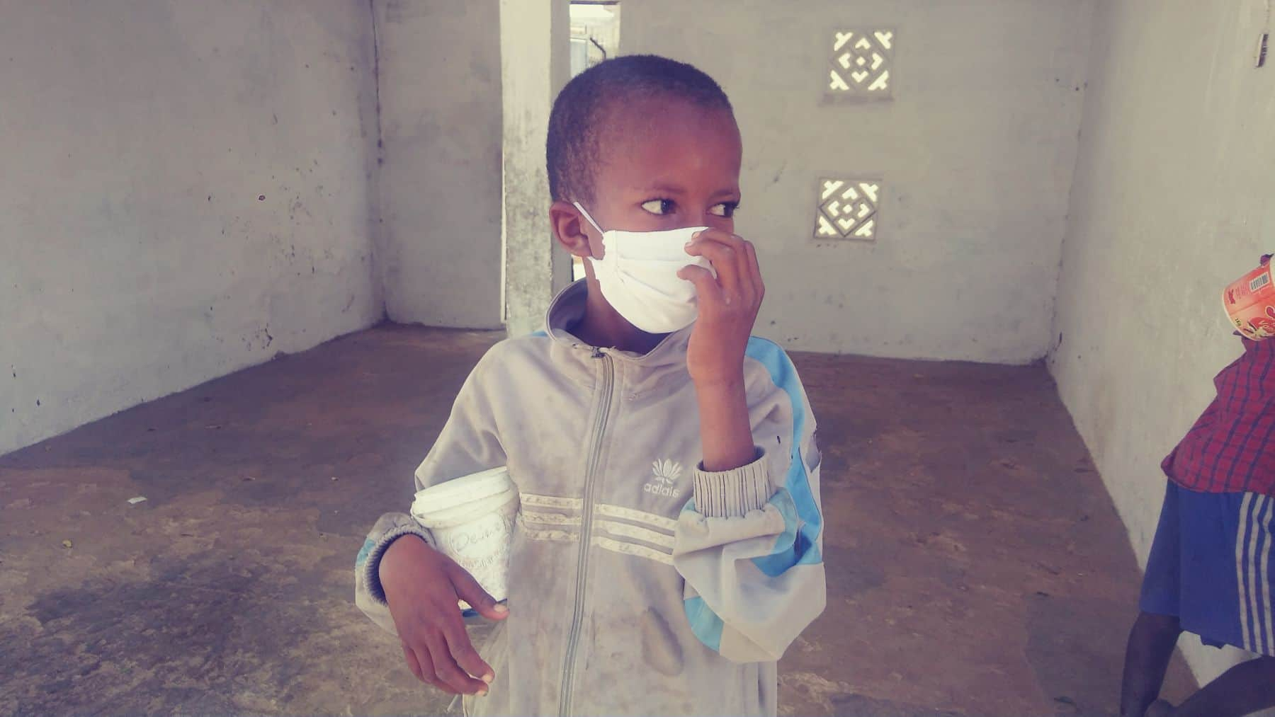 Our partners also keep the children safe with by providing them with masks.