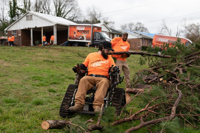 Team Patriot clears yard debris in a hard-it community in Spartanburg, South Carolina, in the aftermath of a powerful tornado earlier this year.