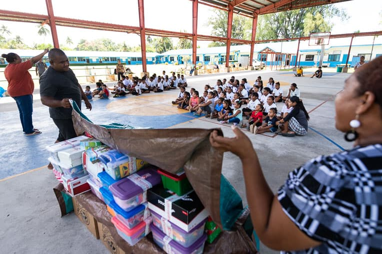 After sharing the Gospel message, ministry partners in Palau unveil shoebox gifts to the children at Peleliu Elementary School.
