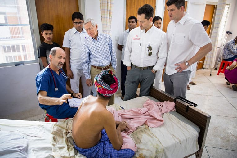 (From left) Dr. Stephen Kelley, Dr. Richard Furman, World Medical Mission Director Dr. Lance Plyler, and Edward Graham meet with a patient in the newly constructed hospital.