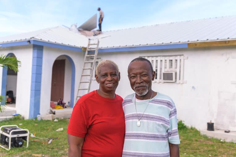 Lisa and Earl Moss rejoice that Samaritan's Purse worked through local contractors to give them a new metal roof.