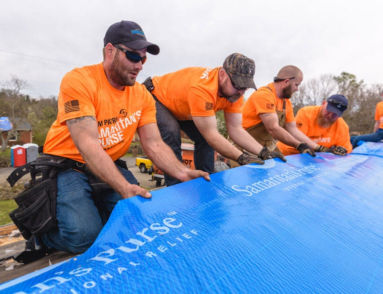 Team Patriot tarps a roof in Cookeville, Tennessee.